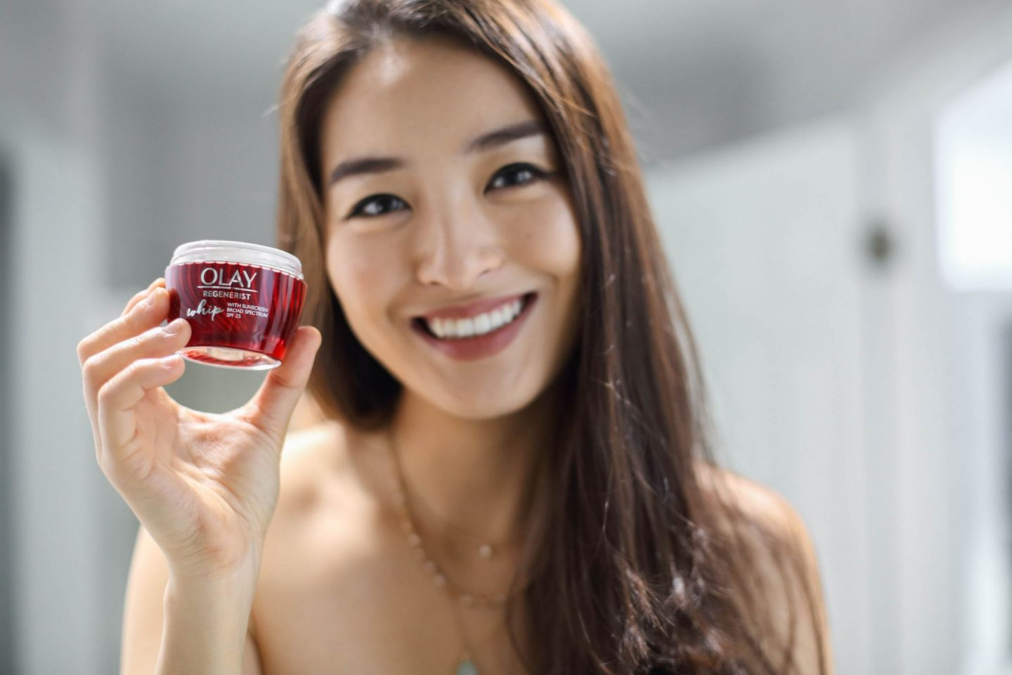 korean fashion blogger with olay whips product