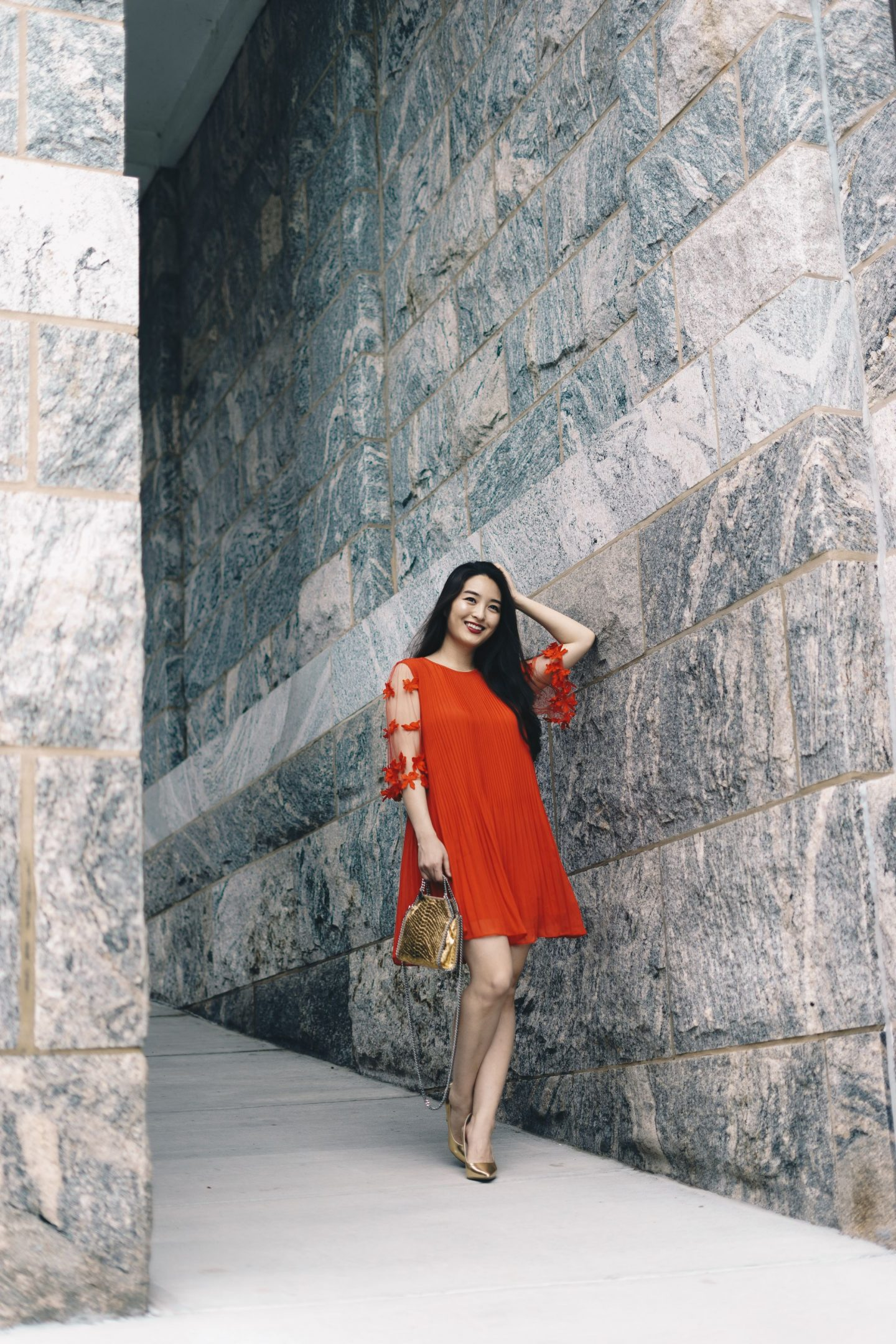 fashion blogger models red dress