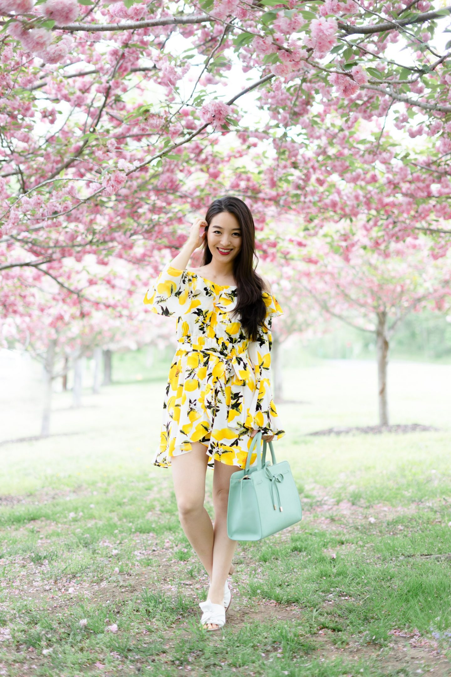 fashion blogger posing under flowers