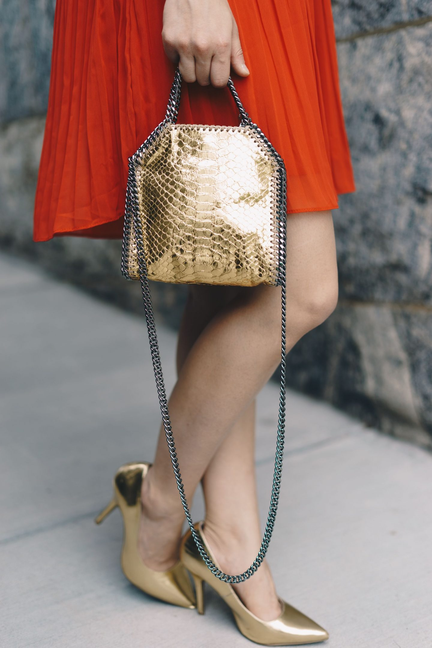 gold shoes and a Stella McCartney gold bag