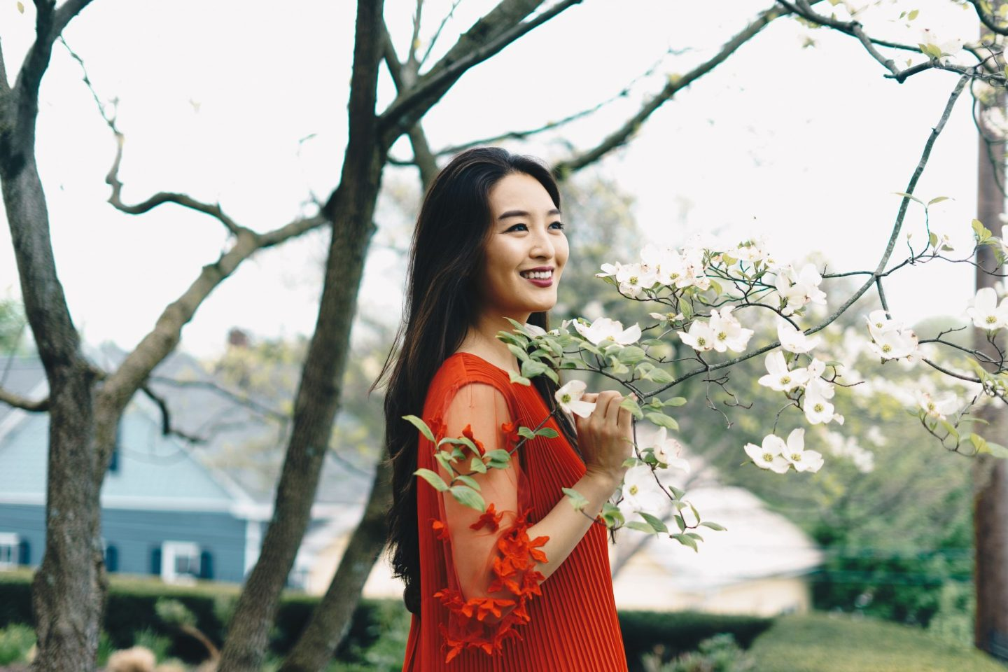 asian blogger wears red dress