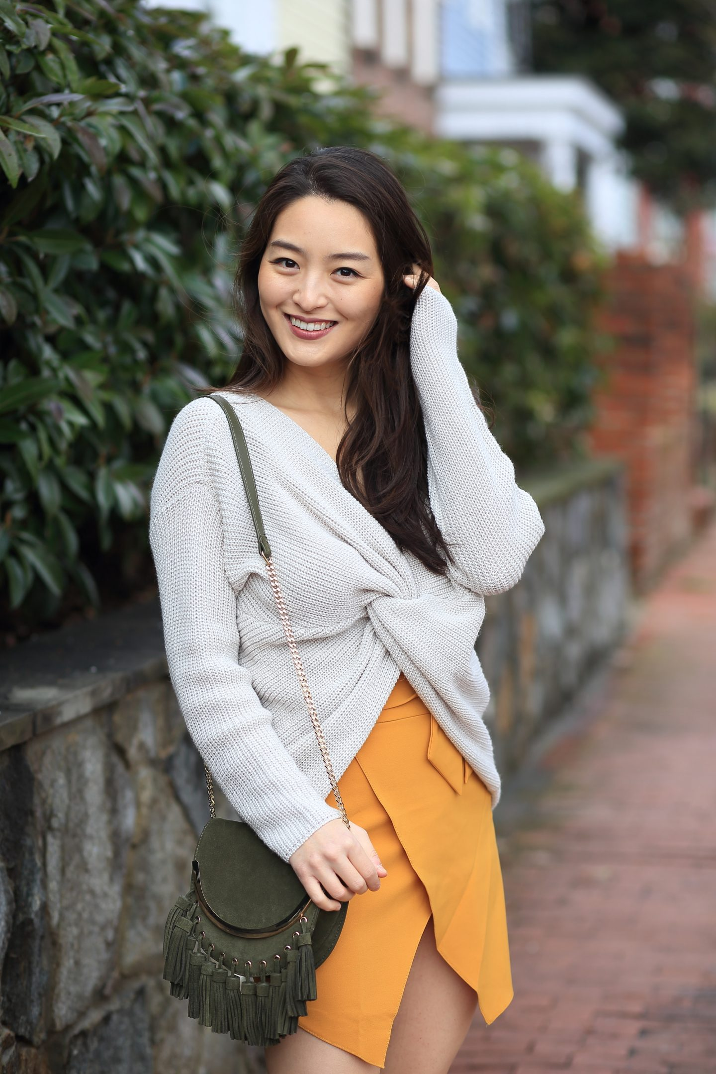 beige knotted sweater