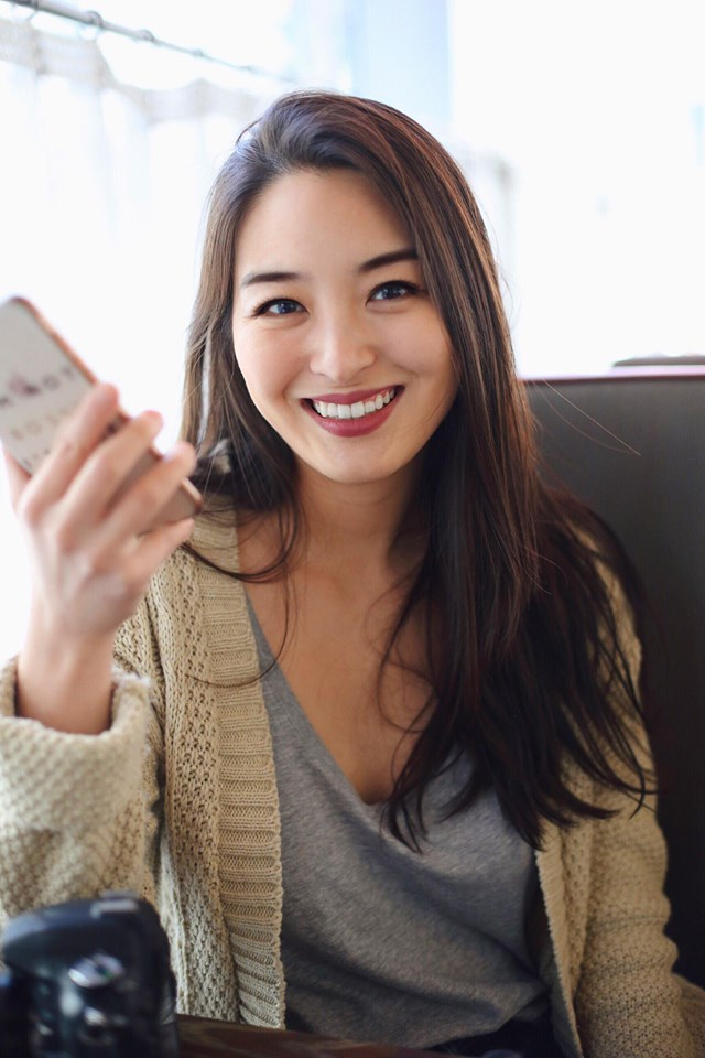 asian blogger with phone